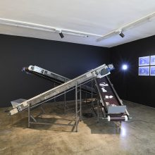 """Emad Anooshirvani, untitled, from """"Funeral for One, Two, or Three Possibly Dead Bodies"""" series, (iron sheet, profile, electric motor, gear box, bearing, mdf, paper, nuts and bolts, timer, shaft), overall size: 400 x 250 x 165 cm, 2019"""