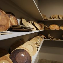 """Mahsa Aleph, from """"The Container Made of the Contained"""" series (Detail), installation of 700 plates in wooden shelves, bread dough, variation of 1000 – 1699, 2019a Aleph, from """"The Container Made of the Contained"""" series, installation of 700 plates in wooden shelves, bread dough, variation of 1000 – 1699, 2019"""