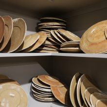 """Mahsa Aleph, from """"The Container Made of the Contained"""" series (Detail), installation of 700 plates in wooden shelves, bread dough, variation of 1000 – 1699, 2019"""