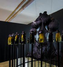"Farda (Maryam Pesyan, Sara Sarkheil) in Collaboration with Soheil Riahi, ""Chapter #1-5-5:30′ "", Installation, Costume Design/ Video , 50 x Bottles Bottles: Glass, Olive Oil, Hair, 2018"