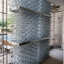 """Mahmoud Bakhshi, from """"Bahman wall"""" project, installation of 8 pieces, galvanized sheet, size: each 126 x 120 x 64 cm, overall size: 480 x 240 cm, edition of 80 (10 x 8) + 8 AP, 2020"""