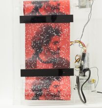 "Untitled, from ""Tapestry"" series, Rolled photograph, glass cube, electric motor, sensors, electric circuits, power adaptor and wiring in plexiglass boxes, 28 x 40 x 10 cm, Unique Edition of 7, 2017"