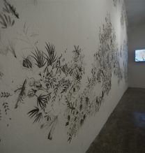 """Zahra Ghyasi, """"0,0,0,100"""", mural drawing with oil and burnt book ashes, 500 x 300 cm, 2018"""