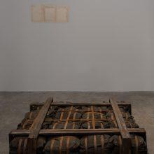 "Majid Biglari, ""February 15, 1945"", from ""The Experience of Dishevelment"" series, mixed media (steel strap, mask satchel, wool, etc.), 113 x 113 x 20 cm, unique edition, 2017"
