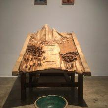 "Mojtaba Amini, ""Foroud (lit.Descent)"", installation, (wood, sheep skin, saper, organic glue, clay pots), maquette, 84 x 75 x 100 cm, 2018"